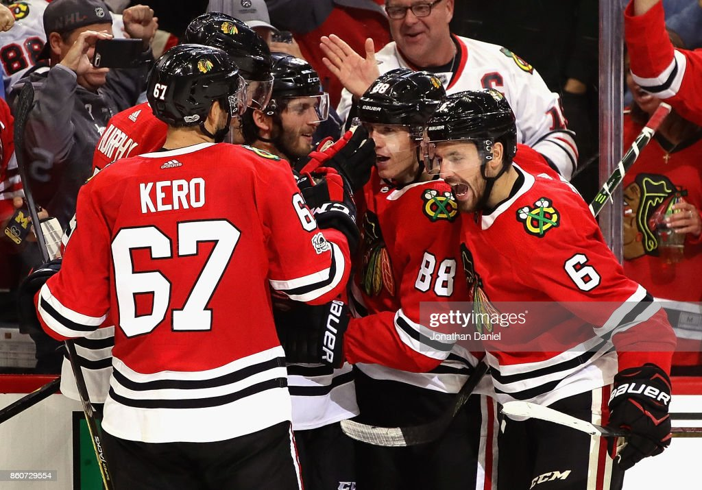 Tanner Kero #67, Connor Murphy #5, Ryan Hartman #38, Patrick Kane #88 and Michal Kempny #6 of the Chicago Blackhawks celebrate Hartman's third period goal against the Minnesota Wild at the United Center on October 12, 2017 in Chicago, Illinois. The Wild defeated the Blackhawks 5-2.