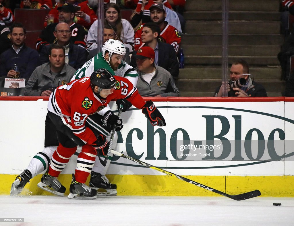 Tanner Kero #67 of the Chicago Blackhawks battles with Greg Pateryn #29 of the Dallas Stars at the United Center on March 23, 2017 in Chicago, Illinois. The Blackhawks defeated the Stars 3-2 in a shootout.