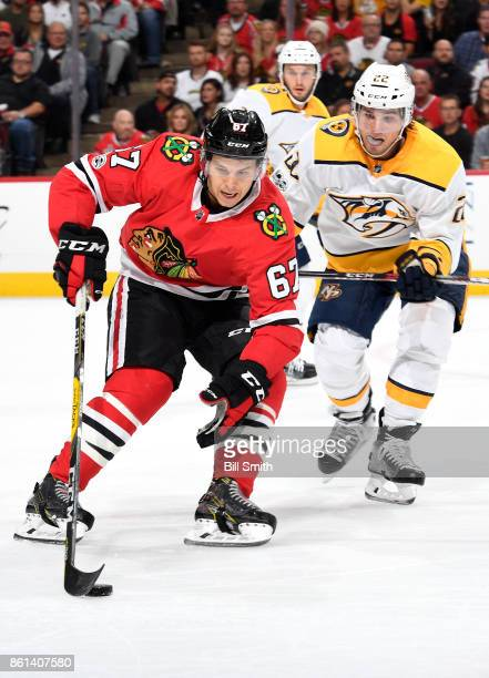 Tanner Kero of the Chicago Blackhawks grabs the puck ahead of Kevin Fiala of the Nashville Predators in the first period at the United Center on...
