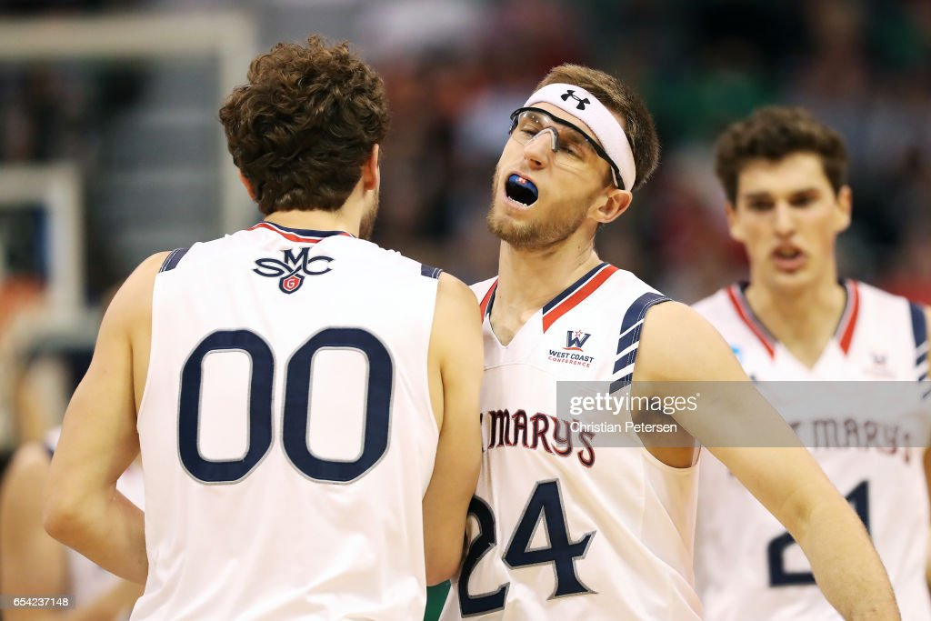 Tanner Krebs #00 and Calvin Hermanson #24 of the St. Mary's Gaels celebrate the play against the Virginia Commonwealth Rams during the first round of the 2017 NCAA Men's Basketball Tournament at Vivint Smart Home Arena on March 16, 2017 in Salt Lake City, Utah.