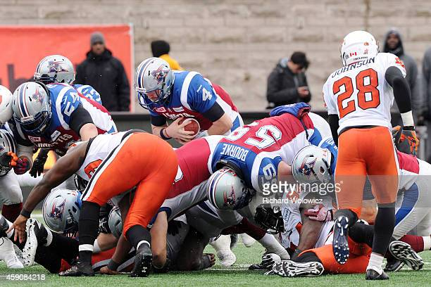 Tanner Marsh of the Montreal Alouettes dives over the line for a first down during the CFL Eastern Division SemiFinal game against the BC Lions at...