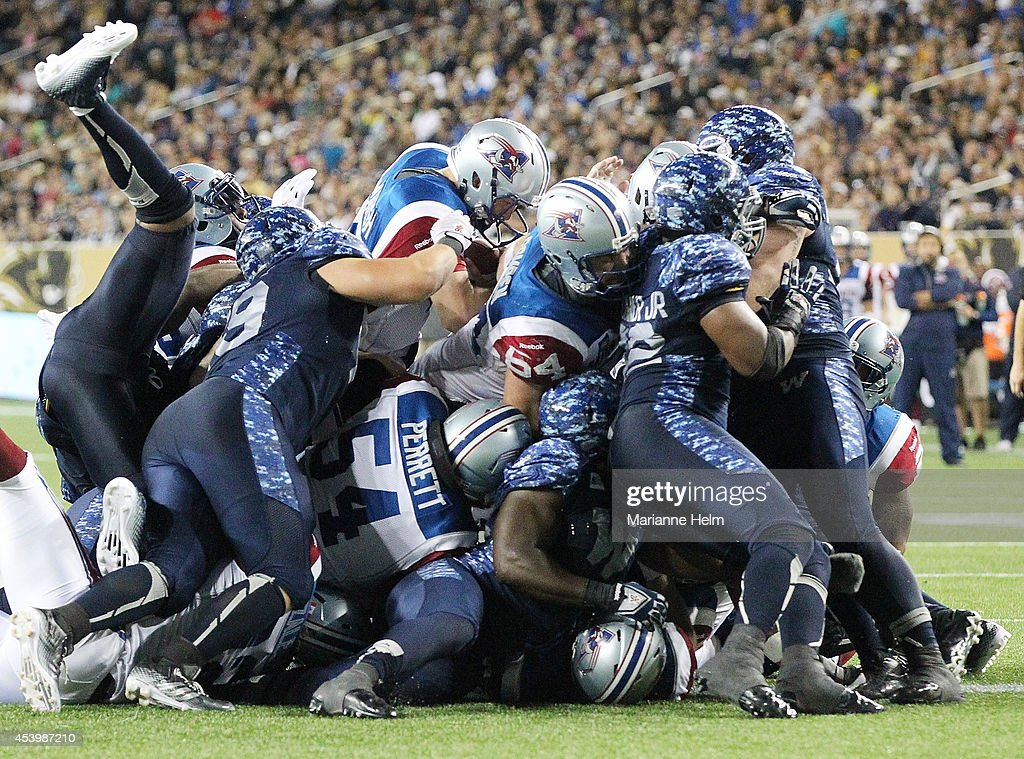 Tanner Marsh #4 of the Montreal Alouettes gets a touchdown in second half action in a CFL game against the Winnipeg Blue Bombers at Investors Group Field on August 22, 2014 in Winnipeg, Manitoba, Canada.