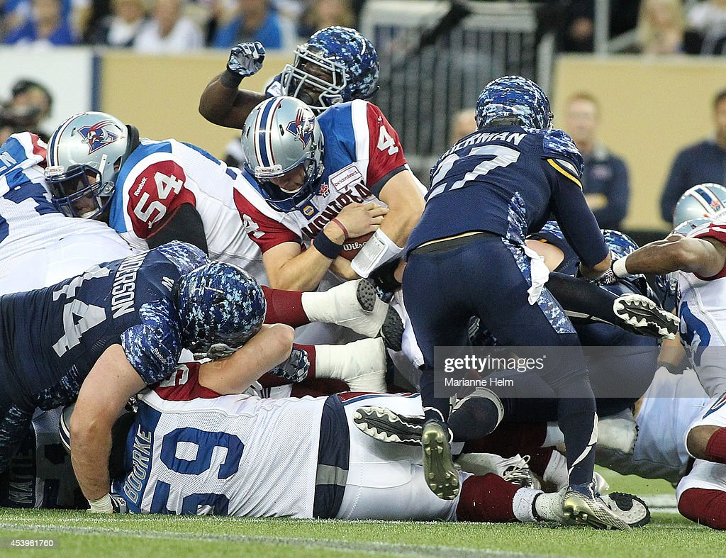 Tanner Marsh #4 of the Montreal Alouettes gets the yard needed for a first down in second quarter action in a CFL game against the Winnipeg Blue Bombers at Investors Group Field on August 22, 2014 in Winnipeg, Manitoba, Canada.
