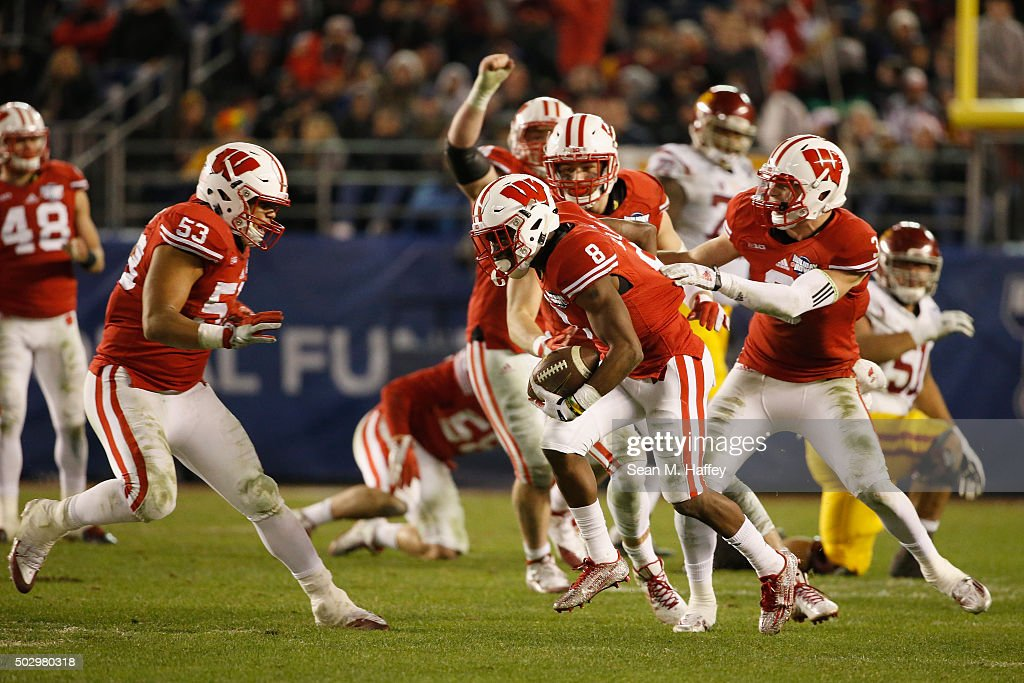 Tanner McEvoy #3 of the Wisconsin Badgers, Sojourn Shelton #8 of the Wisconsin Badgers, Vince Biegel #47 of the Wisconsin Badgers, T.J. Edwards #53 of the Wisconsin Badgers react to a interception during the second half of a game against the USC Trojans in the National University Holiday Bowl at Qualcomm Stadium on December 30, 2015 in San Diego, California.