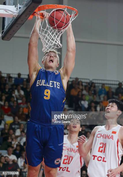 Tanner McGrew of the Bullets dunks the ball during the match between the Brisbane Bullets and China at the Gold Coast Sports Leisure Centre on July...