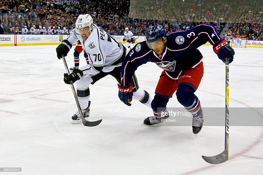 Tanner Pearson #70 of the Los Angeles Kings and Seth Jones #3 of the Columbus Blue Jackets chase after a loose puck during the third period on December 20, 2016 at Nationwide Arena in Columbus, Ohio. Columbus defeated Los Angeles 3-2 in a shootout.