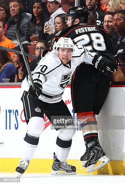 Tanner Pearson of the Los Angeles Kings battles for position against Mark Fistric of the Anaheim Ducks in Game One of the Second Round of the 2014...