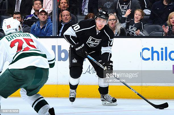 Tanner Pearson of the Los Angeles Kings controls the puck against Jonas Brodin of the Minnesota Wild on January 21 2016 at Staples Center in Los...