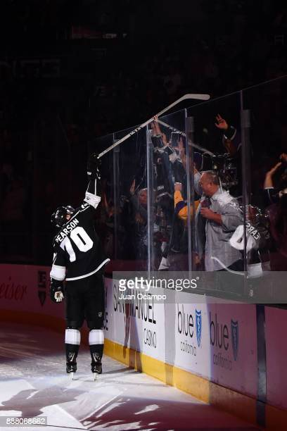 Tanner Pearson of the Los Angeles Kings hands his hockey stick to a fan after a game against the Ottawa Senators at STAPLES Center on December 7 2017...