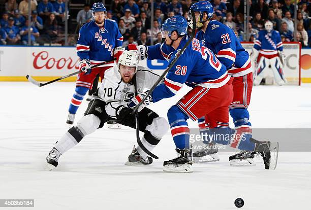 Tanner Pearson of the Los Angeles Kings is defended by Chris Kreider and Derek Stepan of the New York Rangers in the first period of Game Three of...
