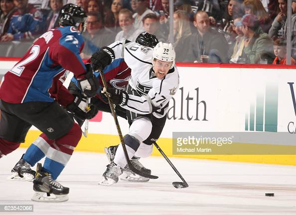 Tanner Pearson of the Los Angeles Kings races to the puck against Joe Colborne and Francois Beauchemin of the Colorado Avalanche at the Pepsi Center...