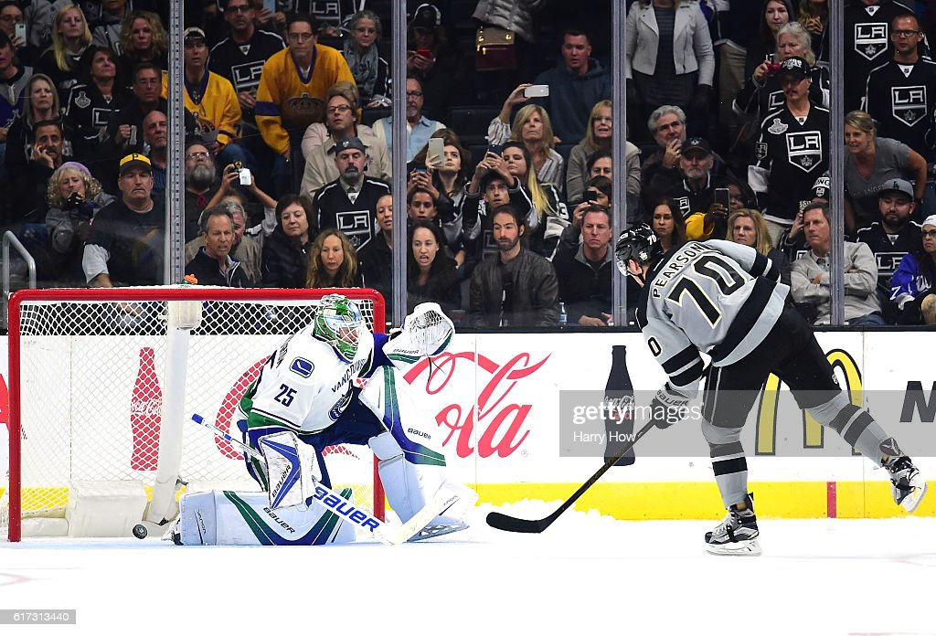 Tanner Pearson #70 of the Los Angeles Kings scores on Jacob Markstrom #25 of the Vancouver Canucks during the overtime shootout period at Staples Center on October 22, 2016 in Los Angeles, California. The Kings would go on to win 4-3.