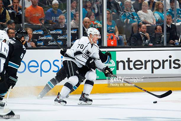 Tanner Pearson of the Los Angeles Kings skates with the puck against the San Jose Sharks in Game Seven of the First Round of the 2014 NHL Stanley Cup...