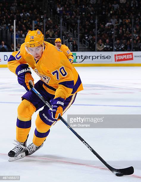Tanner Pearson of the Los Angeles Kings skates with the puck during the game against the Arizona Coyotes on November 10 2015 at Staples Center in Los...