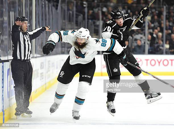 Tanner Pearson of the Los Angeles Kings takes a check from Brent Burns of the San Jose Sharks during the second period at Staples Center on November...