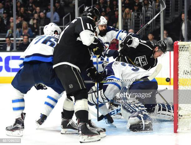 Tanner Pearson of the Los Angeles Kings watches a rebound as he is pushed by Mark Stuart of the Winnipeg Jets during the secod period at Staples...
