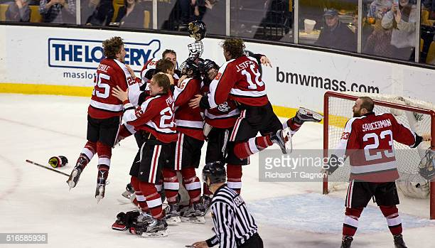 Tanner Pond and John Stevens of the Northeastern Huskies jumps on his teammates Zach AstonReese Nolan Stevens Matt Benning and Ryan Ruck after NCAA...