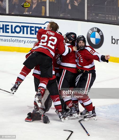 Tanner Pond of the Northeastern Huskies jumps on his teammates Zach AstonReese Nolan Stevens Matt Benning and Ryan Ruck after NCAA hockey as...
