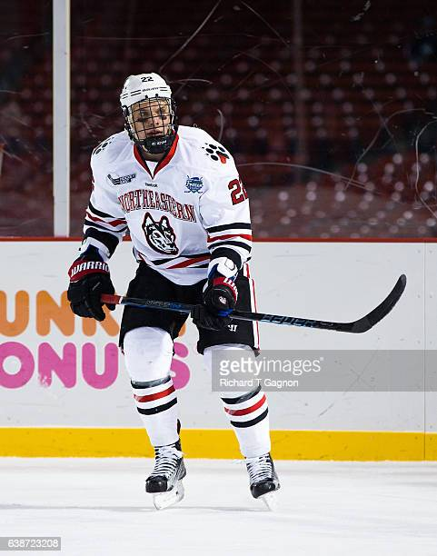 Tanner Pond of the Northeastern Huskies skates against the New Hampshire Wildcats during NCAA hockey at Fenway Park during 'Frozen Fenway' on January...