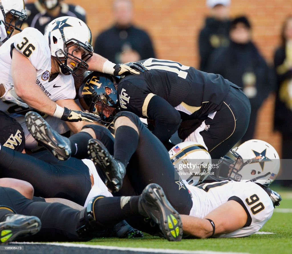 Tanner Price #10 of the Wake Forest Demon Deacons is stopped short of the goalline by the Vanderbilt Commodores defense at BB&T Field on November 24, 2012 in Winston Salem, North Carolina.