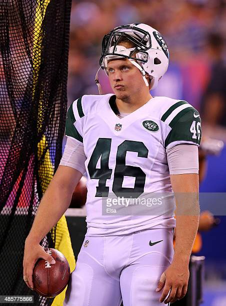 Tanner Purdum of the New York Jets looks on from the sideline in the fourth quarter against the New York Giants during preseason action at MetLife...