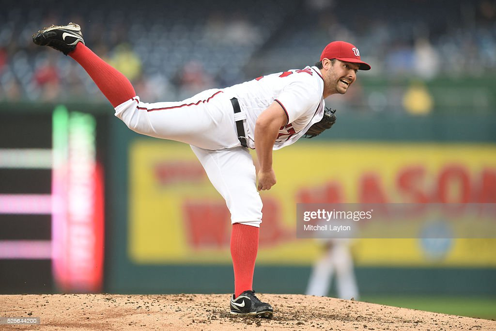 Tanner Roark #57 of the Washington Nationals pitches in the third inning during a baseball game against the Philadelphia Phillies at Nationals Park on April 28, 2016 in Washington, D.C.