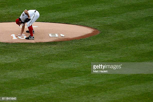 Tanner Roark of the Washington Nationals touches a number 16 memorializing Miami Marlins pitcher Jose Fernandez who died in a boating accident on the...