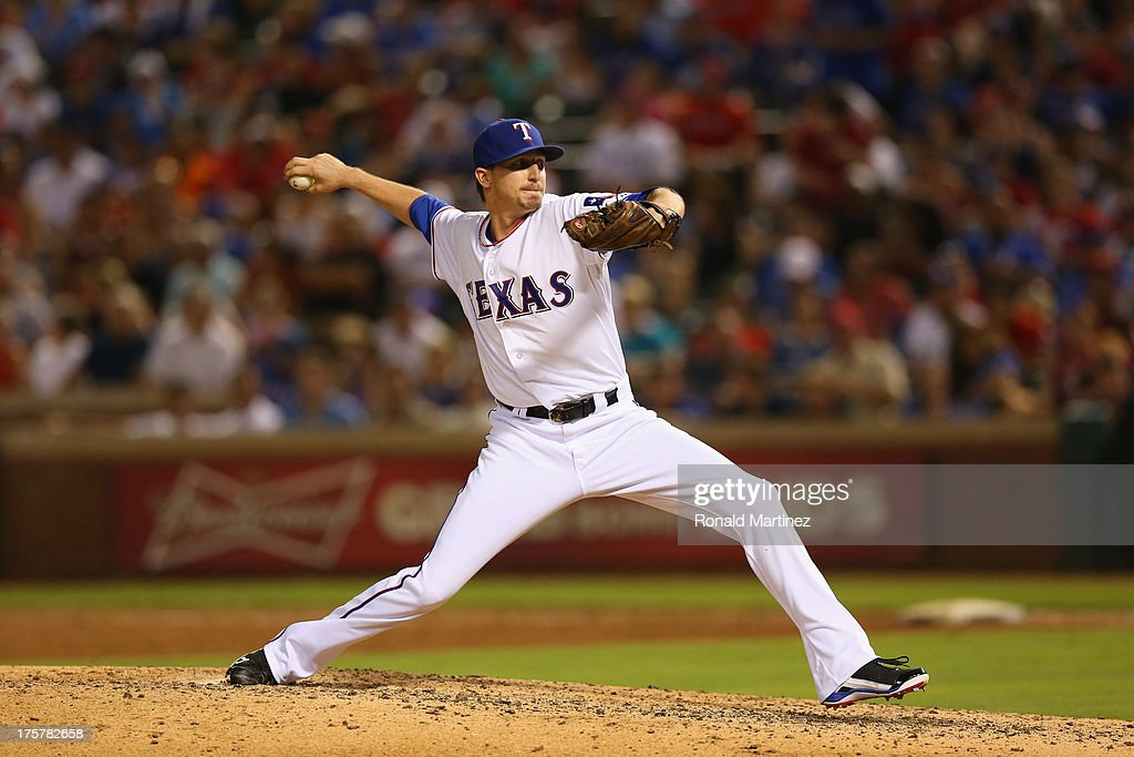 Tanner Scheppers #52 of the Texas Rangers at Rangers Ballpark in Arlington on July 31, 2013 in Arlington, Texas.