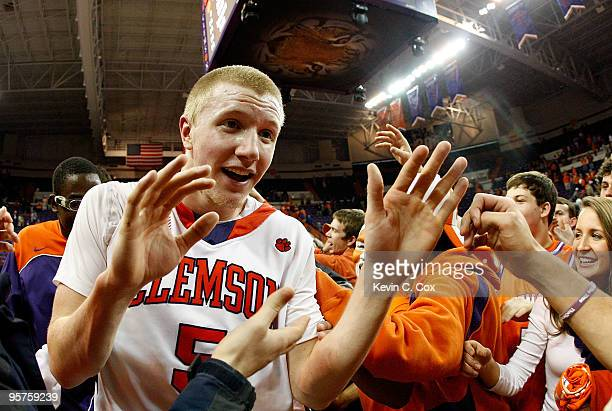 Tanner Smith of the Clemson Tigers celebrates after their 8364 win over the North Carolina Tar Heels at Littlejohn Coliseum on January 13 2010 in...