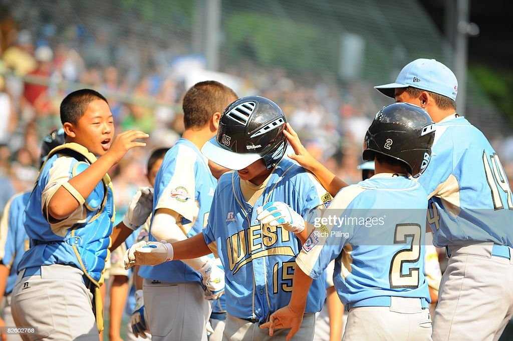 Tanner Tokunaga #15 of the Waipio Little League team is greeted by teammates after hitting a home run during the World Series Championship game against the Matamoros Little League team at Lamade Stadium in Williamsport, Pennsylvania on August 24, 2008. The Waipio team defeated the Matamoros team 12-3.