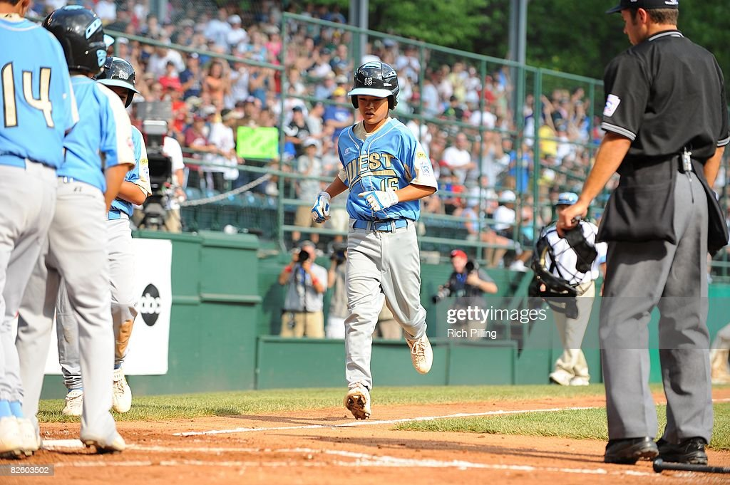 Tanner Tokunaga #15 of the Waipio Little League team runs to home plate after hitting a home run during the World Series Championship game against the Matamoros Little League team at Lamade Stadium in Williamsport, Pennsylvania on August 24, 2008. The Waipio team defeated the Matamoros team 12-3.