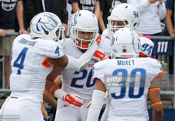 Tanner Vallejo of the Boise State Broncos celebrates his touchdown after he recovered a fumble in the first quarter against the Univeristy of...