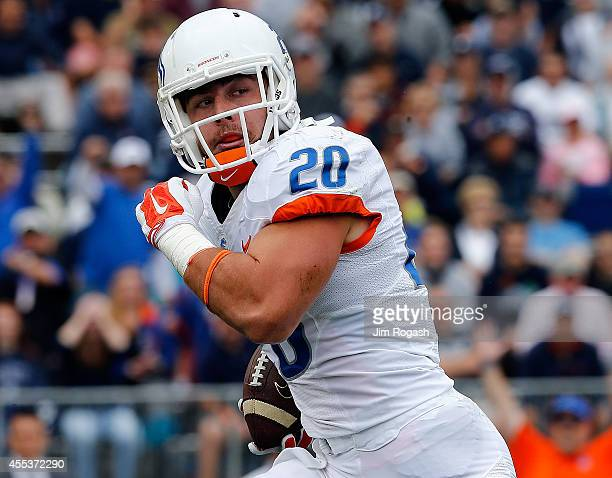 Tanner Vallejo of the Boise State Broncos recovers a fumble and runs into the endzoen for a touchdown in the first quarter against the Univeristy of...
