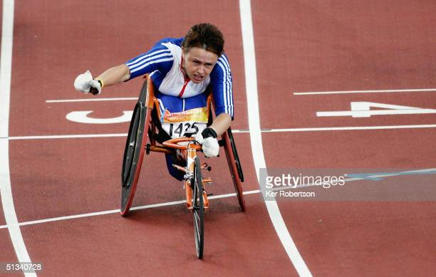 Tanni GreyThompson of Great Britain wins the Womens 100m T53 Final on September 23 during the Athens 2004 Paralympic Games at the Olympic Stadium in...