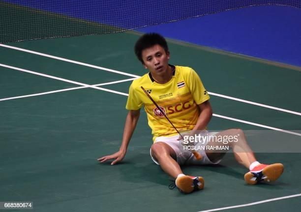 Tanongsak Saengsomboonsuk of Thailand falls to the floor during playing against Sai Praneeth of India during their men's singles quarterfinal match...