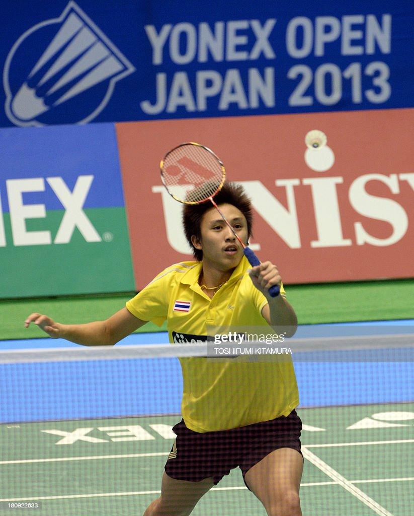 Tanongsak Saensomboonsuk of Thailand hits a return during his