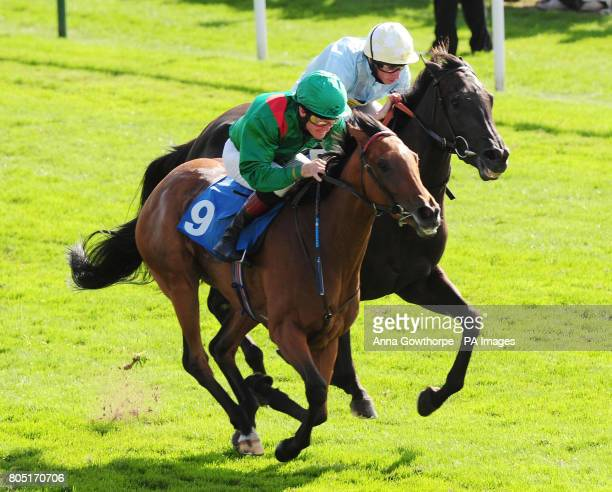 Tanoura ridden by Mick Kinane beats Leocorno ridden by Ryan Moore to win the European Breeders' Fund Galtres Stakes in the Ebor Festival at York...