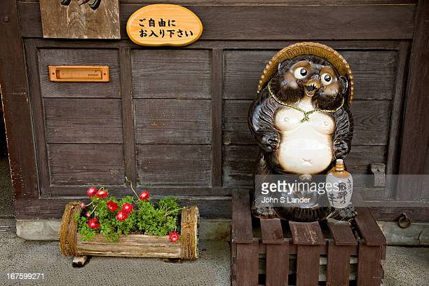Tanuki or Japanese badger on a Sanmachi Street in Takayama often called 'Little Kyoto' in Japan for its tradtional streets and buildings left intact...