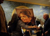 Tanya Ashe from Orlando Florida a member of Team Sarah brought a giant picture of Sarah Palen with thousands of Tea Partier signatures on the back...