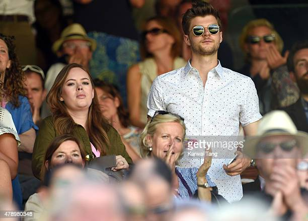 Tanya Burr and Jim Chapman attend the Maria Sharapova v Johanna Konta match on day one of the Wimbledon Tennis Championships on June 29 2015 in...