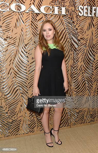 Tanya Burr attends the launch of Coach at Selfridges hosted by Stuart Vevers at Selfridges on September 18 2015 in London England