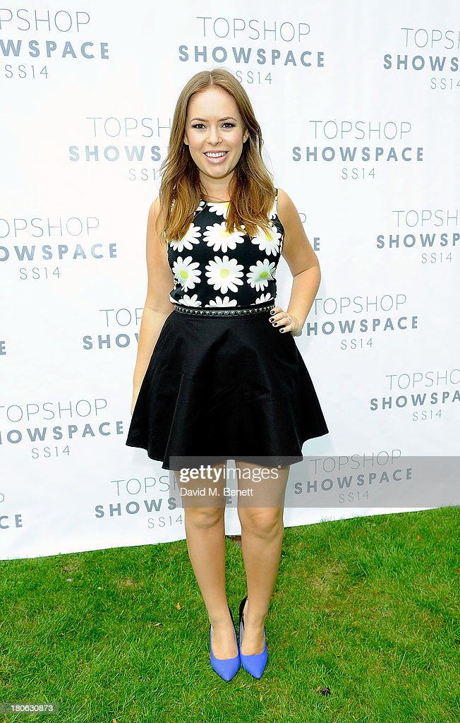 Tanya Burr attends the Unique SS14 show during London Fashion Week on September 15, 2013 in London, England.