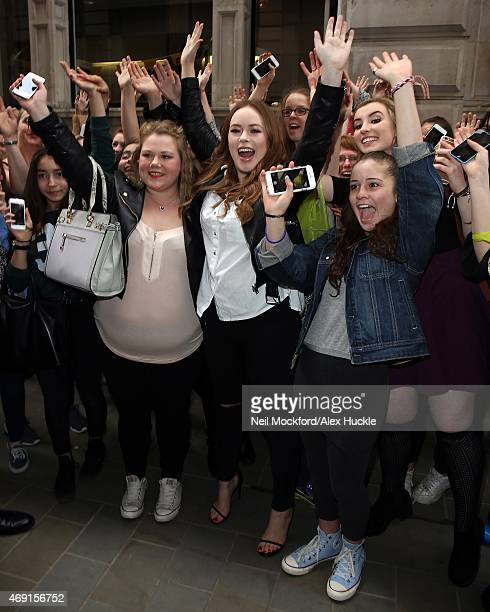 Tanya Burr greets fans outside Waterstones Piccadilly ahead of her book 'Love Tanya' signing on April 10 2015 in London England