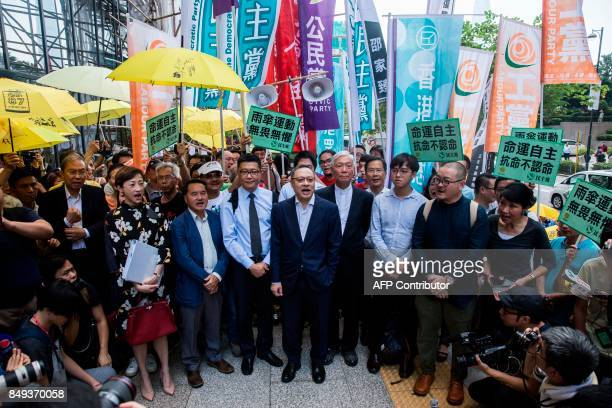 Tanya Chan Lee Wingtat Chan Kinmam Benny Tai and Chu Yiuming chant slogans in front of the District Court before the trial on public nuisance charges...