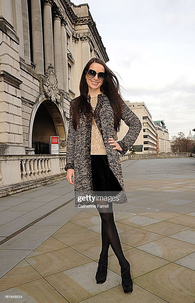 Tanya Kotlyarevskaya, Russian fashionista, wearing Missoni coat, top designed by Tanya Kotlyarevskaya,Valentino skirt,Wolford tights, accessorised with Victoria Beckham shades, Rolex watch and Cartier ring, and Yves st Laurent shoes at London Fashion Week Fall/Winter 2013/14 on February 16, 2013 in London, England.