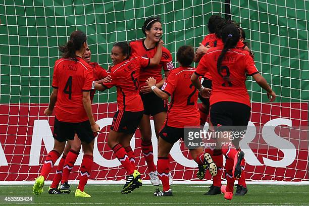 Tanya Samarzich of Mexico celebrates her team's first goal with team mates during the FIFA U20 Women's World Cup Canada 2014 group C match between...