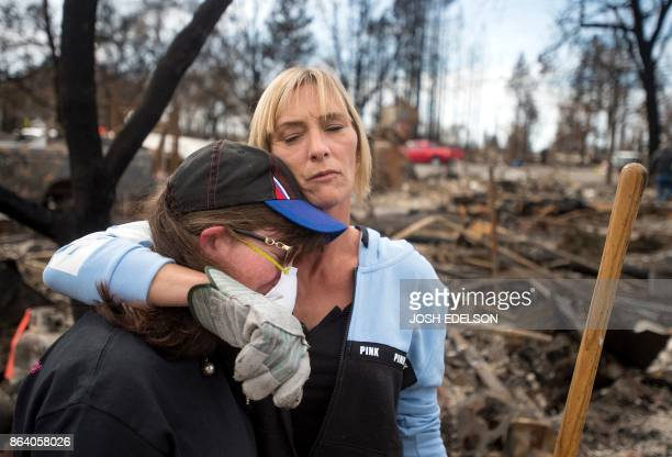 TOPSHOT Tanya Williams consoles her neighbour Dawn Lockhart as they view their burned homes in the Coffey Park area of Santa Rosa California on...
