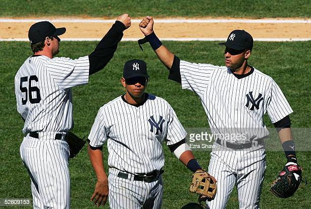 Tanyon Sturtze Derek Jeter and Alex Rodriguez of the New York Yankees react after the seventh inning of their game against the Baltimore Orioles at...