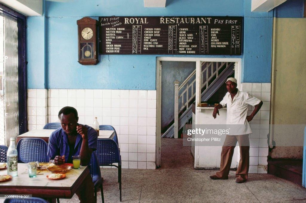 Tanzania, Dar es Salaam, Chef and customer dining in restaurant : Stock Photo
