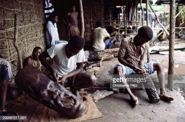 Tanzania, Dar es Salaam, Maconde wood carvers at work